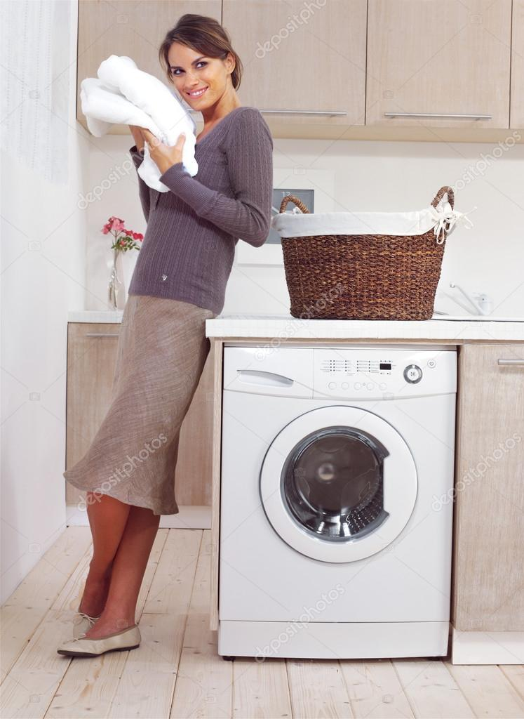 Woman on washing machine ⬇ Stock Photo, Image by © toocan #46754913