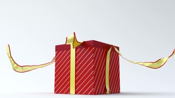 červená dárková krabička se zlatou stužkou, otevření