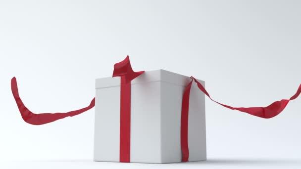 Fehér ajándék doboz-val piros szalag megnyitása