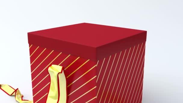 Piros ajándék doboz nyitó arany szalaggal