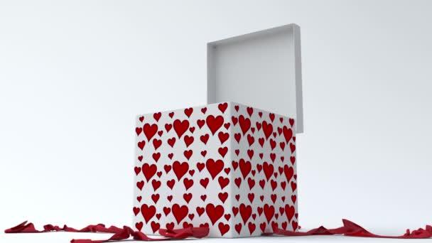 bílá dárková krabička s červeným srdcem otevření