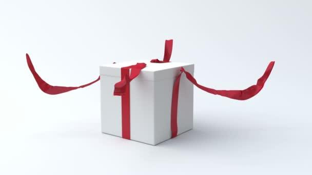 bílé krabičky s červenou mašlí, otevření