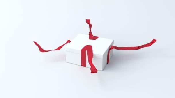 fehér, kis ajándék doboz-val piros szalag megnyitása