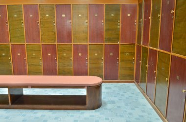 Classic wood locker room and a bench