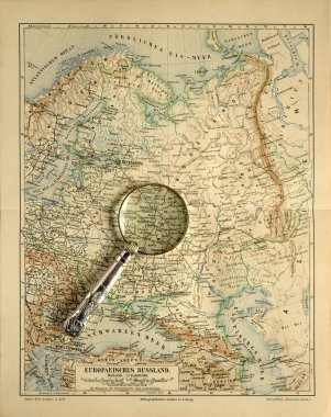 Old map of Russia with magnifying glass