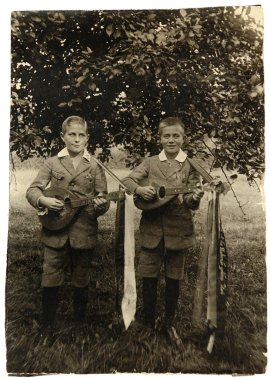 Antique photo Young musicians playing mandolins