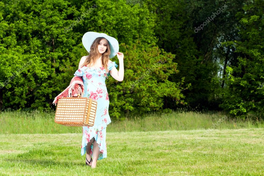 Beautiful woman relaxes on a picnic