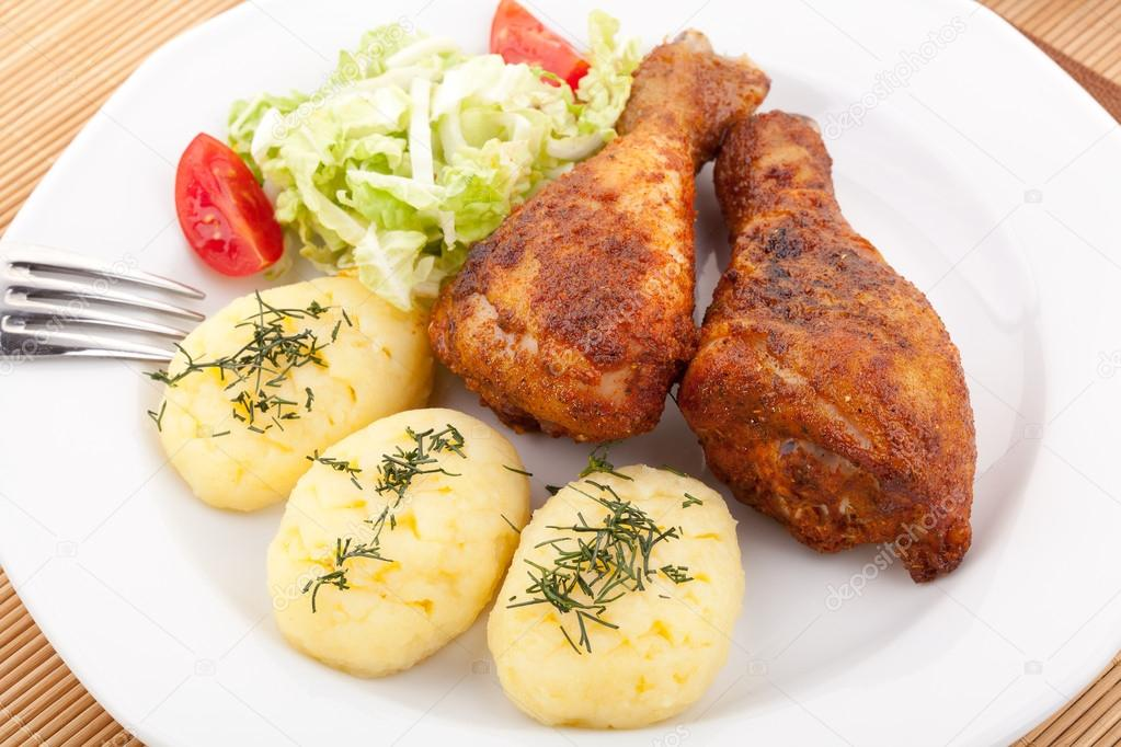 Roasted Chicken Legs With Mashed Potatoes Stock Photo C Gkrphoto