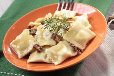 Portion of ravioli with mushrooms and sauerkraut