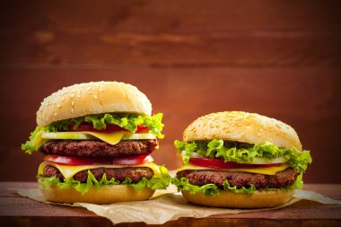 Two hamburgers on wood