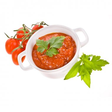 Tomato paste in a white pot, cherry tomatoes