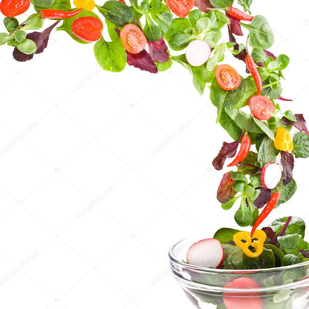 Flying fresh salad isolated over white background