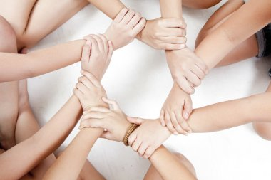 Asian children's hands circle on a white background