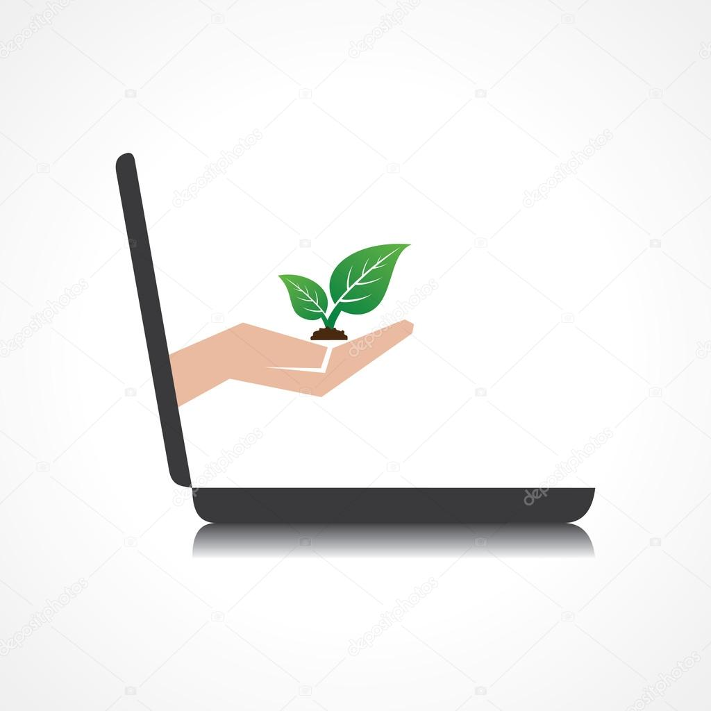 Hand holding plant comes from laptop screen