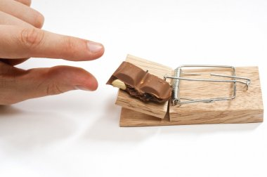 A mousetrap set with chocolate bait