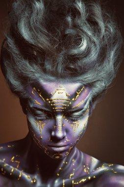 Painted beautiful woman