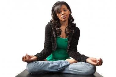 Skeptical Black Woman in Yoga Lotus Pose