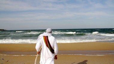 Prophet Reaching the Ocean and Raising Hands
