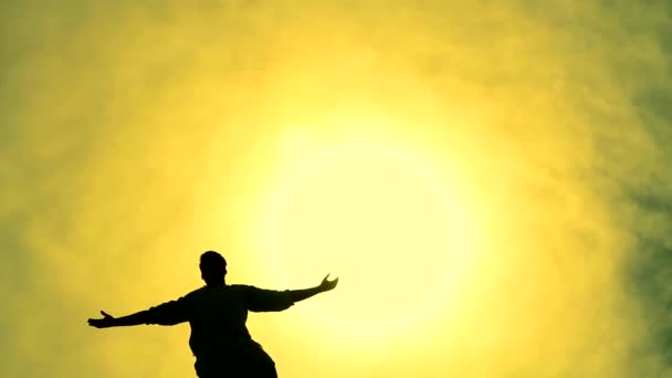 Success Pose by Man on Top of Hill Lifting Hands Sun Color