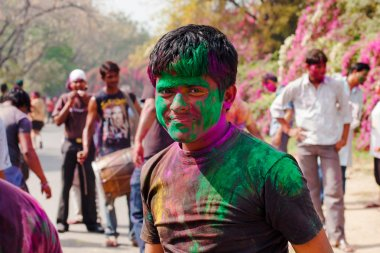 People celebrate festival Holi in Delhi, India. Holi, or Holli,is a spring festival celebrated by Hindus, Sikhs and others. The main day, Holi, is celebrated by people throwing coloured powder and coloured water at each other. stock vector