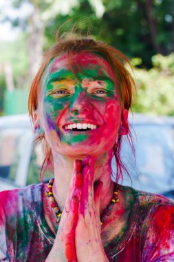 European girl celebrate festival Holi in Delhi, India. Holi, or Holli,is a spring festival celebrated by Hindus, Sikhs and others. The main day, Holi, is celebrated by people throwing coloured powder and coloured water at each other. stock vector