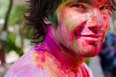 European man celebrate festival Holi in Delhi, India. Holi, or Holli,is a spring festival celebrated by Hindus, Sikhs and others. The main day, Holi, is celebrated by people throwing coloured powder and coloured water at each other. stock vector