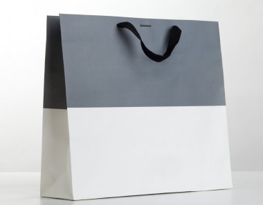 Grey and white shopping bag.