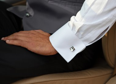 Man with white shirt and cuff link