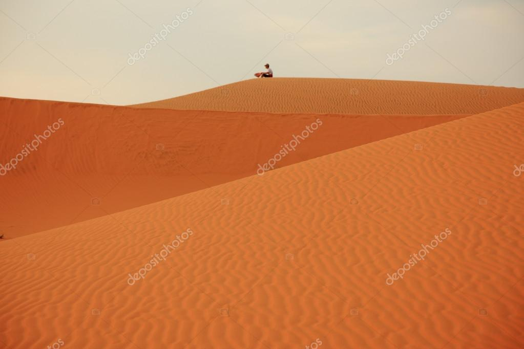 Man siting on sand dunes