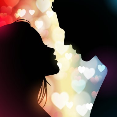 Couple silhouette with hearts in the background
