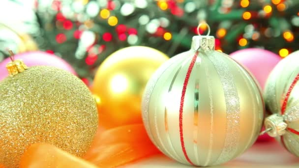 Christmas gold balls decoration with defocused lights and tree background