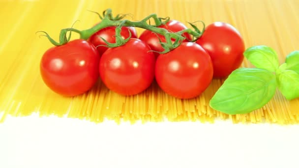 Italian food ingredients on white background, tomatoes with pasta spaghetti, garlic and basil