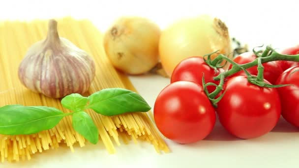 Italian food ingredients on white background, tomato with pasta spaghetti, garlic and basil