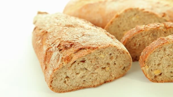 Fresh baked bread and rolls on white background