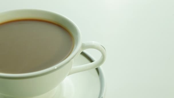 Cup of coffee with milk on white background