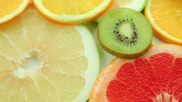 Fruit background, fruits: orange, kiwi, grapefruit, lemon, lime, pomelo