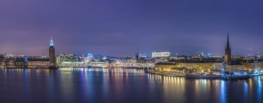 Stockholm City Hall and Riddarholmen by night.
