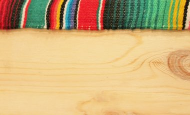 Mexican Wooden edged boarder serape poncho textile copy space cinco de mayo background stock, photo, photograph, image, picture,