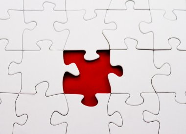 Blank jigsaw puzzle missing piece red