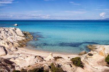 Little sandy beach between the rocks, in Sithonia, Chalkidiki, Greece