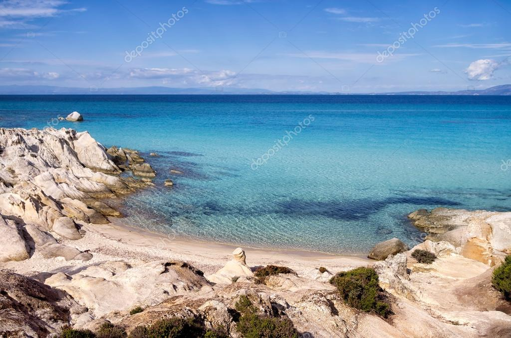 Little sandy beach between the rocks, in Sithonia, Chalkidiki, Greece