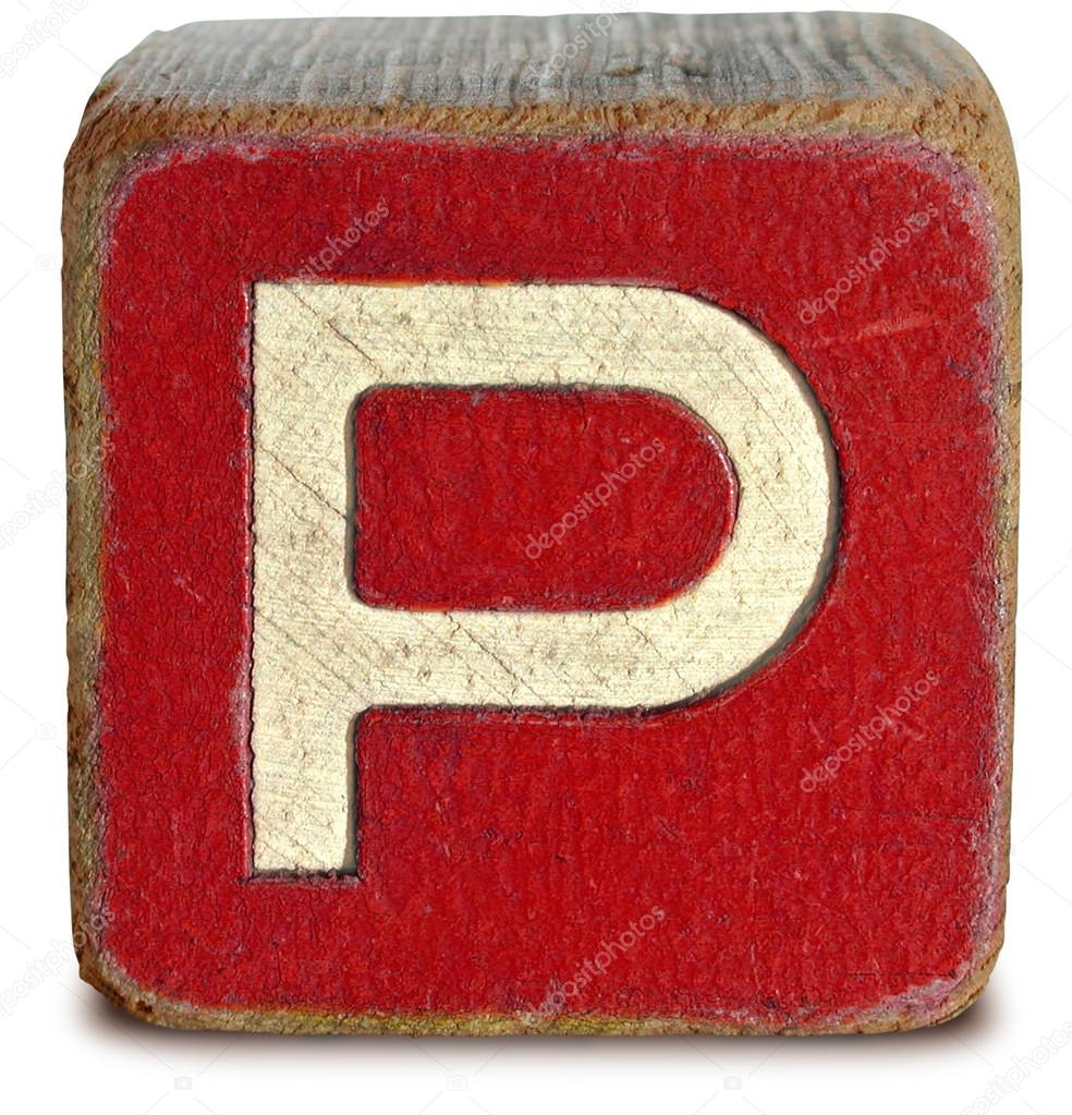photograph of red wooden block letter p stock photo