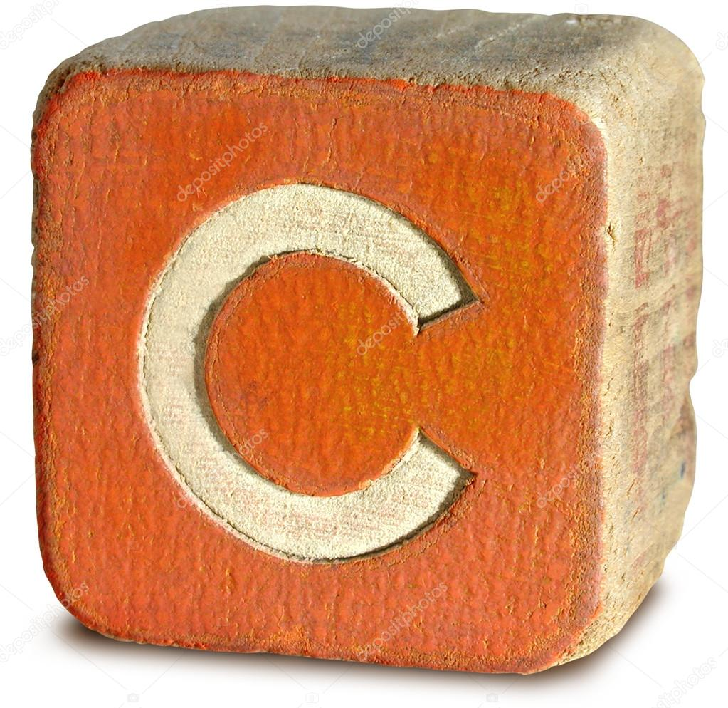 Photograph of orange wooden block letter c stock photo for C letter block