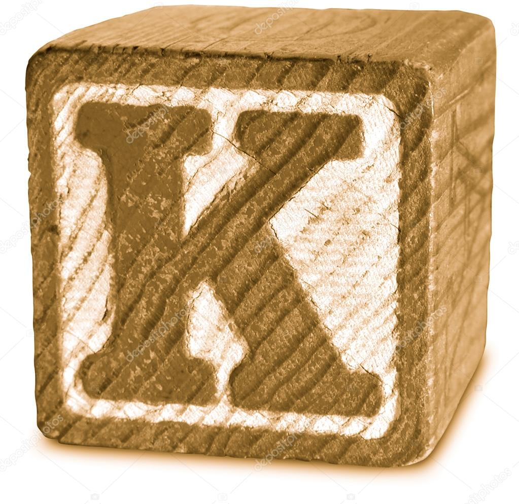 sepia wooden block letter k stock photo