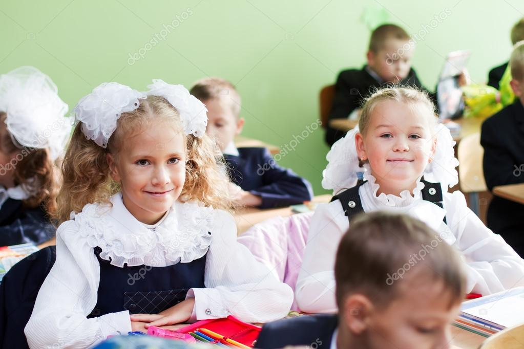 Two girls in the classroom on the first lesson of the first of S