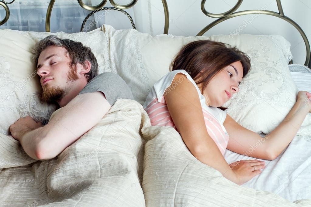 Young husband and wife sleeping on the bed in bedroom   Stock Photo   34158459. Young husband and wife sleeping on the bed in bedroom   Stock
