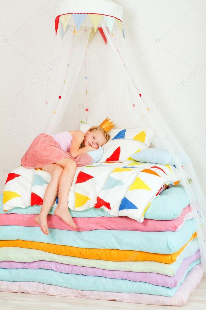 girl lying on a pile of mattresses Stock Photo marishu 41855961