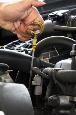 Mechanic check the oil in the engine
