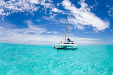 Catamaran in Bora Bora blue lagoon