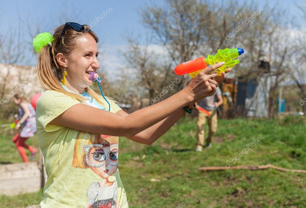 Outdoor games using water guns